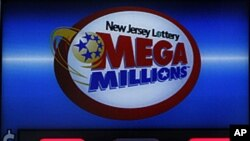 A storefront sign displays the jackpot total of Mega Millions lottery in Hoboken, New Jersey, March 30, 2012.