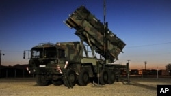 FILE - A Patriot surface-to-air missile battery is pictured at a training ground in Fort Bliss near El Paso, Texas, Feb. 15, 2012.