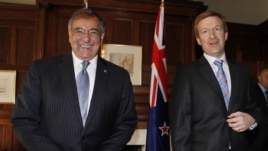 U.S. Secretary of Defense Leon Panetta, left, smiles next to his New Zealand counterpart Jonathan Coleman at the Government House in Auckland, New Zealand, Sept. 21, 2012.