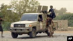 FILE - This still image taken from video provided by Arab 24 shows Saudi-led forces fighting to retake the international airport of Yemen's rebel-held port city of Hodeida from Shi'ite Houthi rebels, June 16, 2018.