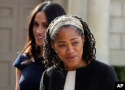 Meghan Markle, background, and her mother, Doria Ragland, arrive at Cliveden House Hotel, in Berkshire, England, May 18, 2018 to spend the night before her wedding to Prince Harry on May 19.