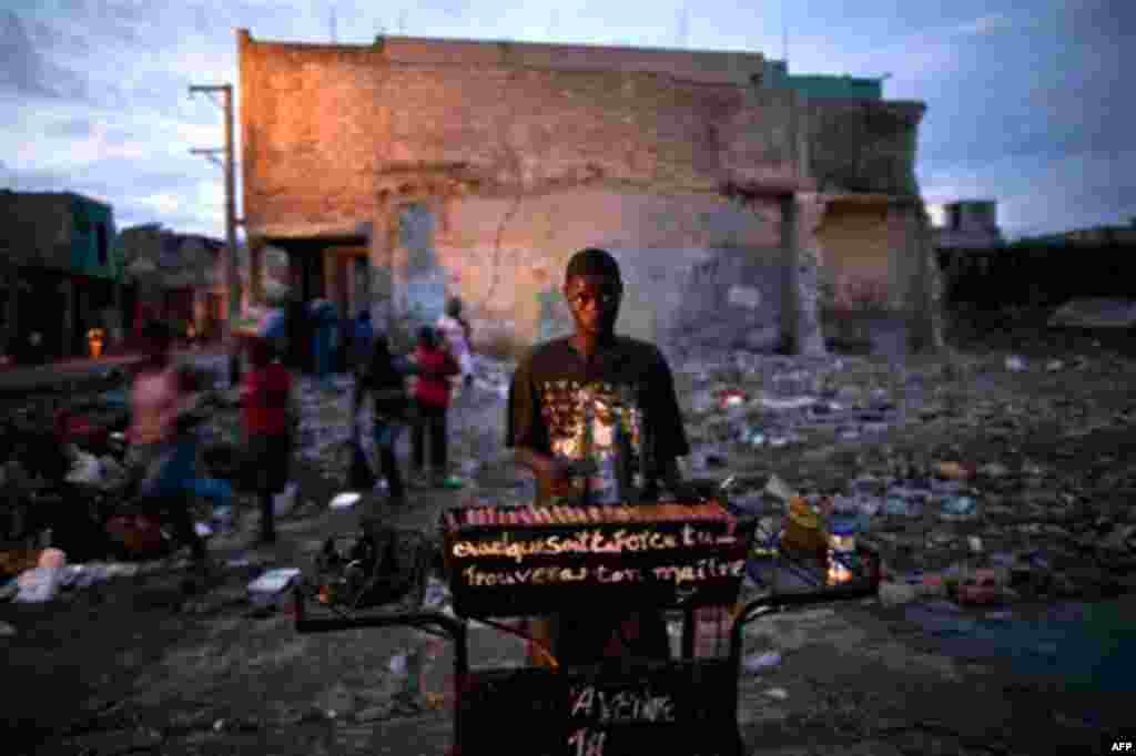 A hot dog vendor works in downtown Port-au-Prince, Haiti, Friday Oct. 8, 2010. (AP Photo/Ramon Espinosa)