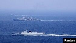 Des navires chinois participent à un entraînement à l'est de la mer de Chine, le 1er août 2016.