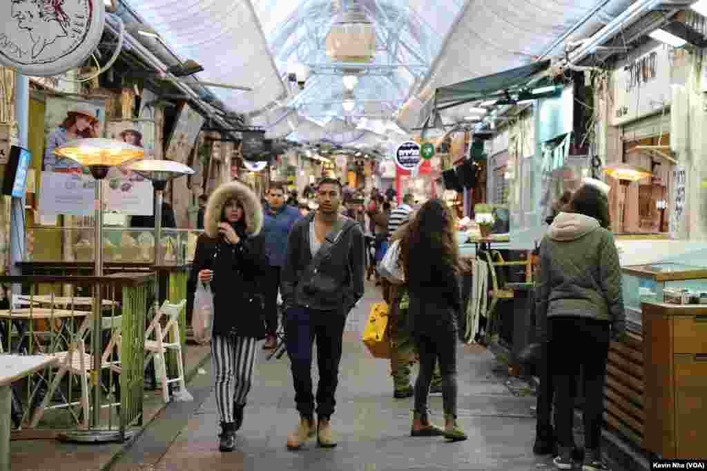 اورشلیم به روایت عکس- مردم در بازار قدیمی شهر اورشلیم به نام «ماهانه یهودا».