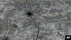 An image made from gun-camera video taken on July 4, 2015, and released by U.S. Central Command shows an airstrike on a main road and transit route near Raqqa, Syria. A Turkish news agency published a map Wednesday, showing 10 U.S. locations in northern Syria, prompting Pentagon concerns.