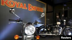 FILE - Royal Enfield motorcycles are displayed at Royal Enfield's flagship shore in Bangkok, Thailand, Feb. 24, 2016.