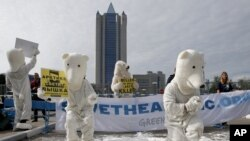 Greenpeace activists dressed as polar bears protest outside Gazprom's headquarters in Moscow, September 5, 2012.