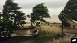 Trees are lashed by strong winds in Sambava, Madagascar, March 7, 2017 as heavy rains and strong winds from a cyclone hit northeast Madagascar, raising concerns about flooding and landslides.
