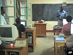 Daniel Macharia, a tutor from Kenya, teaches a class at the Kakuma Distance Learning Center in northern Kenya, Aug 2010
