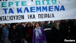 "Greek protesters march against government policies affecting pensioners in Athens, Greece, Dec. 15, 2016. The banner reads ""Bring back what you have stolen."""