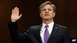FILE - Christopher Wray is sworn in on Capitol Hill in Washington, July 12, 2017, prior to testifying at his confirmation hearing before the Senate Judiciary Committee.