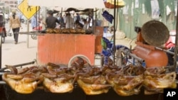 Grilled chickens are sold at a stall in front of the main market in Siem Reap province, some 230 kilometers (143 miles) northwest of the capital Phnom Penh, file photo.