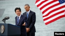 Japanese Prime Minister Shinzo Abe, left, speaks as U.S. President Barack Obama looks on at Joint Base Pearl Harbor-Hickam, Hawaii, Dec. 27, 2016.