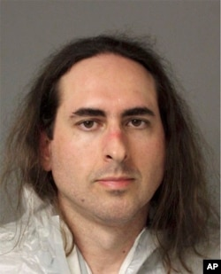 In this June 28 2018 photo released by the Anne Arundel Police, Jarrod Warren Ramos poses for a photo, in Annapolis, Maryland. First-degree murder charges were filed Friday against Ramos who police said targeted Maryland's capital newspaper, shooting his