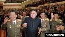 North Korean leader Kim Jong Un reacts during a celebration for nuclear scientists and engineers who contributed to a hydrogen bomb test, in this undated photo released by North Korea's Korean Central News Agency (KCNA) in Pyongyang, Sept. 10, 2017.