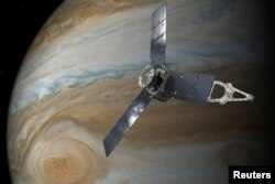 NASA's Juno spacecraft in orbit above Jupiter's Great Red Spot is seen in this undated handout illustration obtained by Reuters, July 11, 2017.