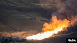 The second and final qualification motor (QM-2) test for the Space Launch System's booster is seen, June 28, 2016, at Orbital ATK Propulsion System's (SLS) test facilities in Promontory, Utah. During the SLS flight the boosters will provide more than 75 percent of the thrust needed to escape the gravitational pull of the Earth, the first step on NASA's Journey to Mars. Photo Credit: (NASA/Bill Ingalls)