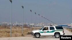 FILE - A U.S. Border Patrol truck sits at the U.S.-Mexico border in El Paso, Texas.