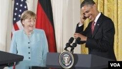 Presiden Barack Obama dan Kanselir Jerman Angela Merkel dalam konferensi pers bersama di Gedung Putih, Selasa (7/6).
