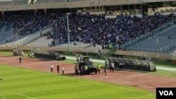 "In this photo shared on social media, an Iranian military vehicle is deployed at Tehran's Azadi Stadium on Aug. 10, 2018, in an apparent effort to quiet football fans chanting ""Death to the dictator"" ahead of a match."