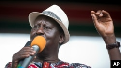 Kenyan opposition leader Raila Odinga addresses his supporters during a rally in the Uhuru Park in Nairobi, Kenya, Oct. 25, 2017.
