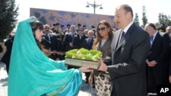 Azerbaijani President Ilham Aliyev and his wife Mehriban Aliyeva attend Norouz festivities in Baku, March 20, 2012.