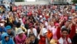 Garment factory workers block a street during a protest in Phnom Penh, file photo.