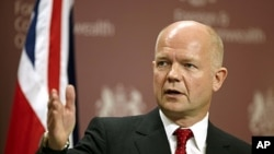 British Foreign Minister William Hague address the media during a news conference at the Foreign and Commonwealth Office in London, July 27, 2011