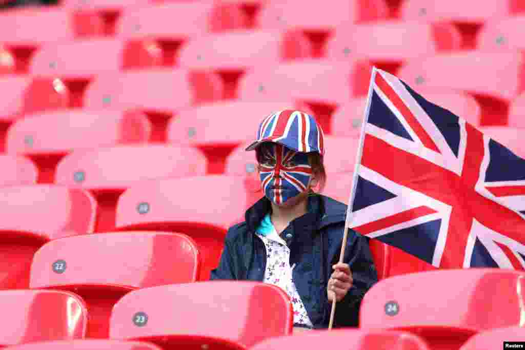 A British fan waits for the Britain - Brazil women's Group E football match at the London 2012 Olympic Games at Wembley Stadium in London July 31, 2012.