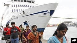 Indian passengers disembark the Scotia Prince passenger ferry, as it arrives from the Tuticorin port of India, to Colombo port, June 14, 2011