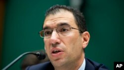 Andrew Slavitt, group executive vice president for Optum/QSSI testifies before the House Energy and Commerce Committee, Washington, Oct. 24, 2013.