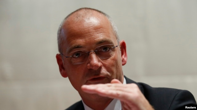 Fonterra Chief Executive Theo Spierlings talks to the media in Beijing, Aug. 5, 2013.