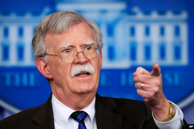 FILE - National security adviser John Bolton speaks to reporters during the daily press briefing at the White House.