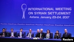 Delegates to the International Meeting on Syrian Settlement in Astana, Kazakhstan hold a news conference after talks ended on January 24, 2017. The meeting was organized by Russia, Turkey and Iran.