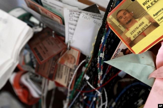 FILE - Dozens of deportee bracelets hang from a cross inside a migrant shelter in Ciudad Juarez, Mexico, Nov. 14, 2016.