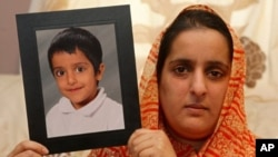 In Oldham, Manchester, northwest England, Akila Naqqash, holds a picture of her five-year-old son, Sahil Saeed, who was kidnapped while visiting his grandmother in Jhelum, Pakistan, 4 Mar 2010
