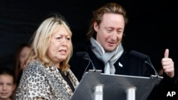 Cynthia Lennon and her son, Julian, appear at the unveiling of a European peace monument dedicated to the memory her former husband and his father, John Lennon, in Chavasse Park, Liverpool, England, Oct. 9, 2010.