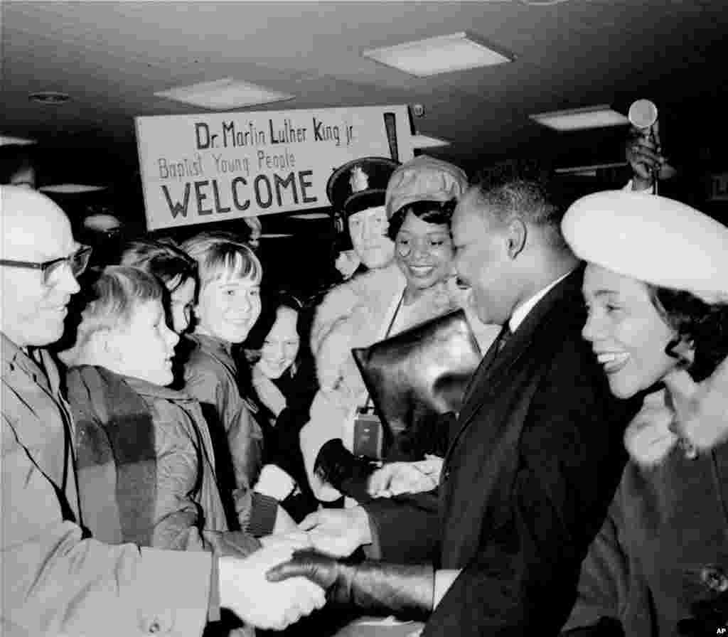 Martin Luther King, Jr. is welcomed by Baptist youths on arrival in Oslo, Norway, to accept the Nobel Peace Prize, Dec. 8, 1964.