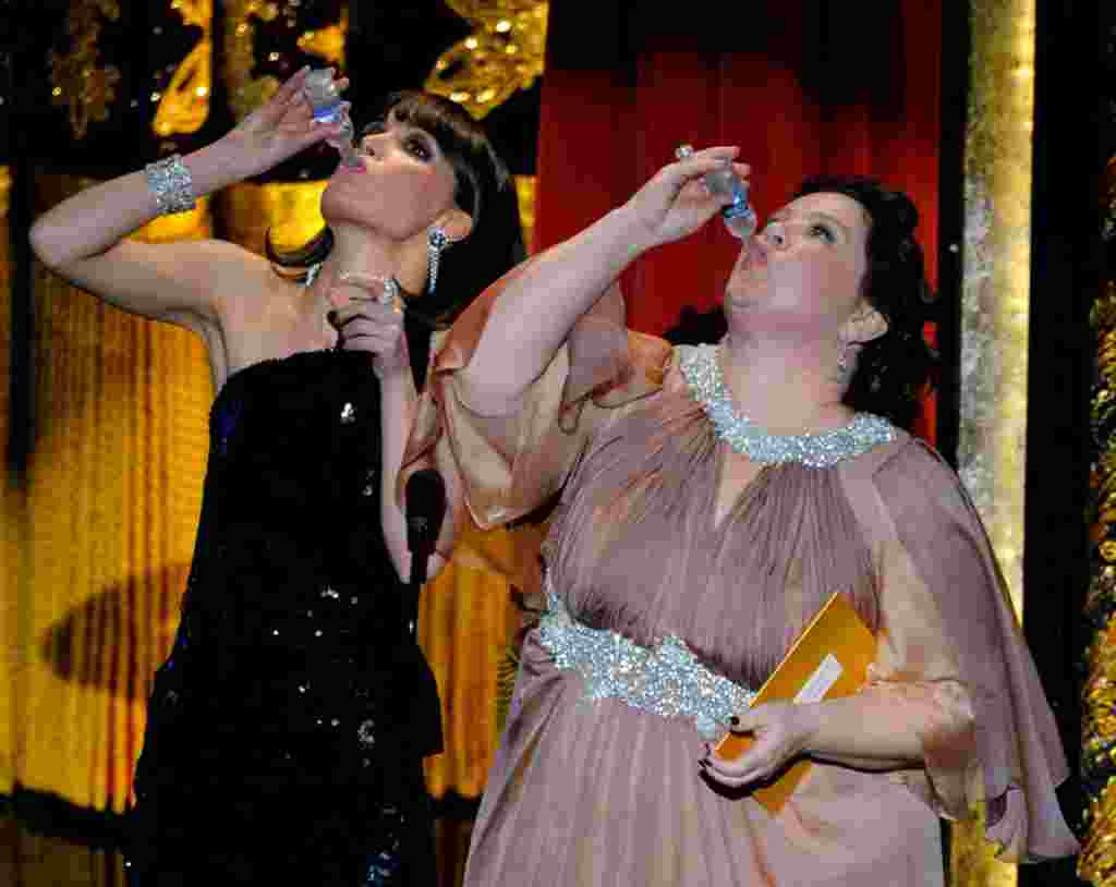 """Members of the cast of """"Bridesmaids"""" Rose Byrne and Melissa McCarthy drink a toast to Martin Scorsese, whose film """"Hugo"""" won several awards. (AP)"""