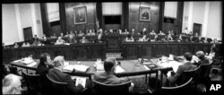 FILE - This was the scene in the hearing room of the House Judiciary Committee in Washington, July 25, 1974, as the panel began another day of debate on the question of impeaching President Richard Nixon.