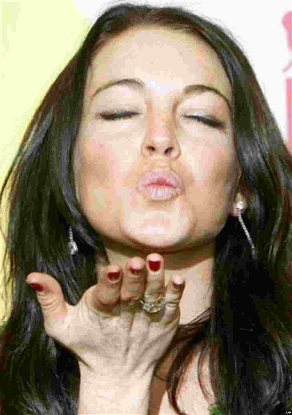 ** FILE ** Actress Lindsay Lohan blows a kiss during a photocall following a news conference to present the film 'Bobby' at the 63rd edition of the Venice film festival in Venice, Italy, in this file photo taken Tuesday, Sept. 5, 2006. Hard to believe now
