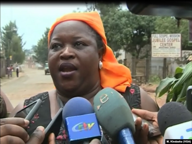 Clotilda Wah, spokesperson of the Northwest and Southwest Women's Task Force, speaks during a protest in Bamenda, Cameroon. (M. Kindzeka/VOA)