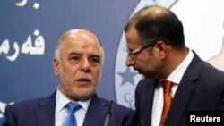 Salim al-Jabouri, right, Speaker of the Iraqi Council of Representatives, and Prime Minister-designate Haidar al Abadi, during news conference, Baghdad, July 15, 2014.