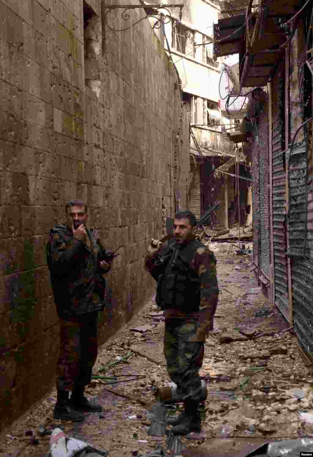 Forces loyal to Syria's President Bashar al-Assad deploy in Al-Suwayqa, Aleppo after capturing it from the Free Syrian Army, Feb. 25, 2013.