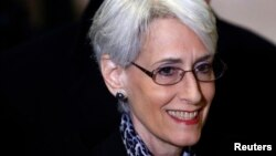 FILE - U.S. Under Secretary of State for Political Affairs Wendy Sherman arrives for a meeting at the United Nations European headquarters in Geneva, Feb. 13, 2014.