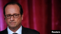 French President Francois Hollande addresses journalists after a meeting at the Elysee Palace in Paris, Sept. 9, 2014.