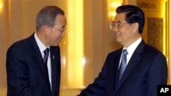 U.N. Secretary-General Ban Ki-moon, left, shakes hands with China's President Hu Jintao during their meeting in the Great Hall of the People in Beijing on Monday, 1 Nov 2010