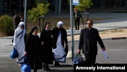 FILE - Catholic nuns and a priest arrive on the Israeli side of the Erez Crossing, after leaving the Gaza Strip.