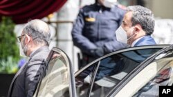 Political deputy at the Ministry of Foreign Affairs of Iran, Abbas Araghchi, right, arrives at the Grand Hotel Wien where closed-door nuclear talks with Iran take place in Vienna, Austria, Tuesday, April 6, 2021. (AP Photo/Florian Schroetter)