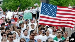 People participate in 'A Day Without Immigrants' rally, May 1, 2006 at the Civic Center Plaza in Tulsa, Okla., where according to the U.S. Census Bureau, Tulsa had a 97 percent increase in Hispanic population from 2000 to 2010, while the suburb of Owasso